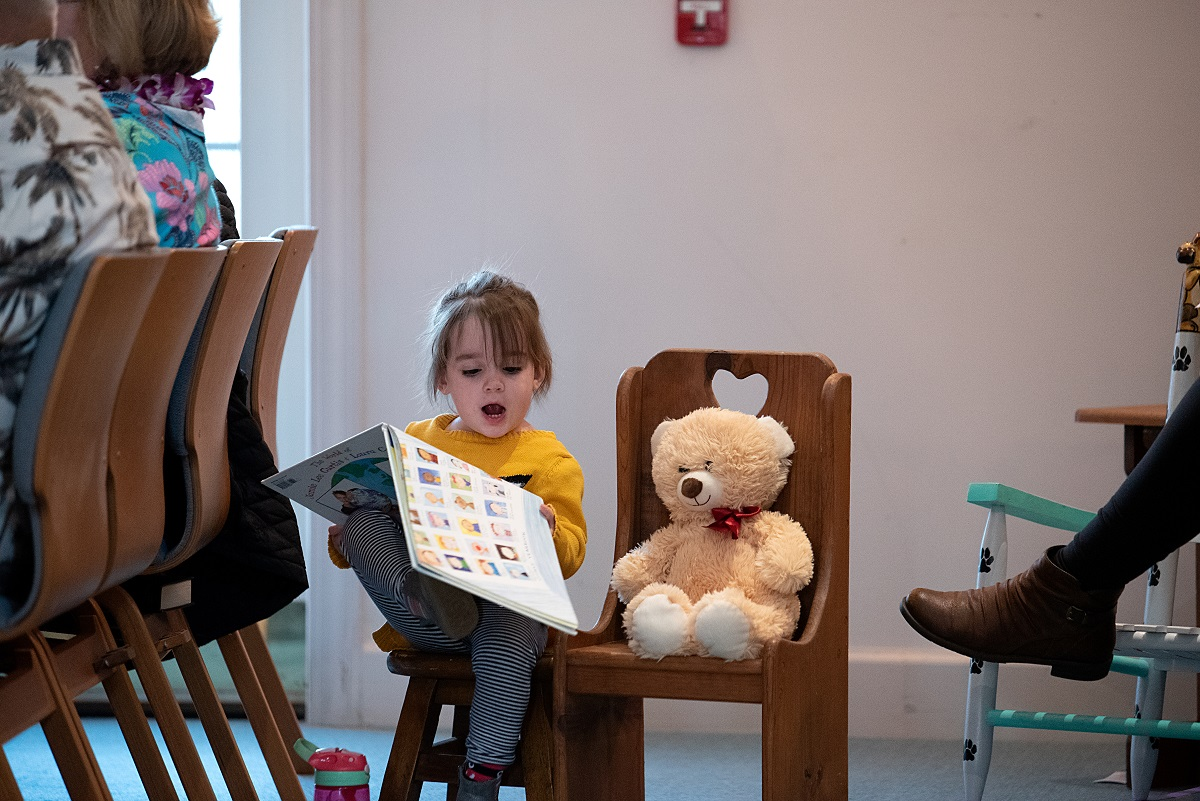 Child Reading at Congregational Church of Pinehurst