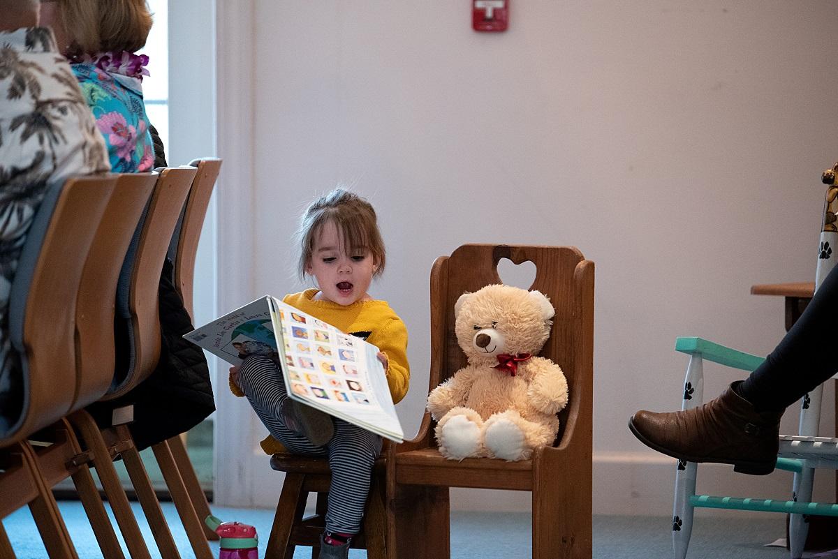 Child Reading at Congregational Church of Pinehurst